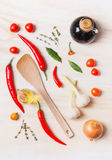 Spices and oil selection with cooking spoon on white wooden background, top view, flat lay. Royalty Free Stock Photos