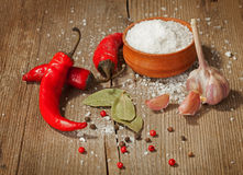 Spices on old wooden background Royalty Free Stock Photo