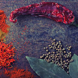 Spices on a old wooden cutting board Stock Images