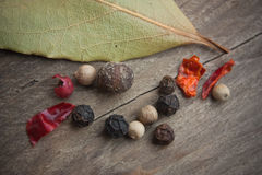 Spices on old wooden table Stock Photos