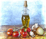 Spices, olive oil, cherry tomatoes Royalty Free Stock Photography