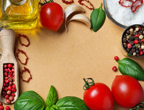 Spices, olive oil, tomatoes and blank sheet of paper Royalty Free Stock Images