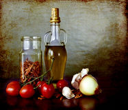 Spices, olive oil, tomatoes, dry peppers. Still life, essential ingredients for a healthy nutrition: ripe tomatoes, olive oil,garlic, onion and spices on a Stock Images