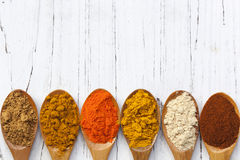 Free Spices On Wooden Spoons Stock Images - 38761904