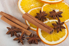 Spices and orange. Cinnamon sticks, anise stars, and dried orange slices Royalty Free Stock Images