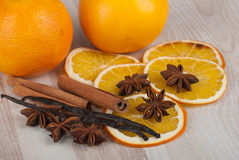 Spices and orange. Cinnamon sticks, anise stars, vanilla and orange Royalty Free Stock Images