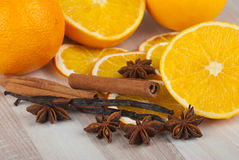 Spices and orange. Cinnamon sticks, anise stars, vanilla and orange Stock Images
