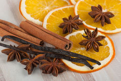 Spices and orange. Cinnamon sticks, anise stars, vanilla and dried orange slices Royalty Free Stock Photos