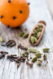 Spices and orange with clove buds. Stock Photos