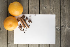 Spices and oranges on white sheet of paper and boards Stock Images