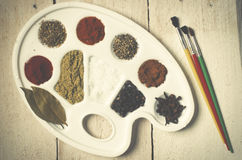 Spices on the paint pallet on wood, Stock Images