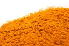 Spices - pile of Yellow Turmeric over white Royalty Free Stock Photo