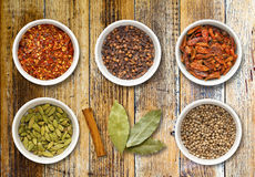 Spices in Pots on a Distressed Wooden Board Stock Photography