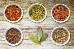 Spices in Pots on Old Wooden Chopping Board Royalty Free Stock Photos