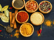 Spices powder and seeds seasoning in wooden bowls Stock Photo