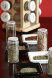 Spices with rack red. Spices with spice rack and red background Stock Photo