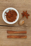 Spices and ramekin on wood Stock Photography