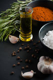 Spices, rosemary, allspice, garlic, oil and salt Royalty Free Stock Photography