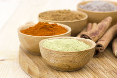 Spices - rosemary, pepper, cardamon, cinnamon Royalty Free Stock Photo