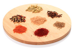 Spices on a round board Stock Photos