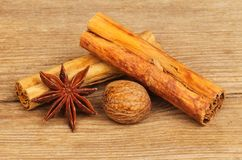Spices on rustic wood. Star anise, cinnamon and nutmeg on old weathered wood Royalty Free Stock Images