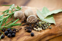Spices on rustic wooden background Royalty Free Stock Images