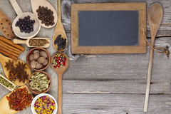 Spices on rustic wooden board Stock Photography