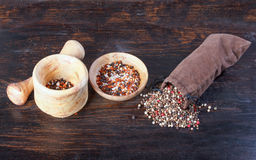 Spices in a sack, bulk spices in a porcelain cup, a spoon, a woo Stock Photo