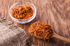 Spices saffron in a glass bowl and spoon Stock Photos