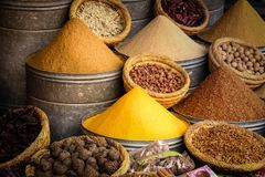 Spices for sale at Souk. Marrakesh. Morocco. Piles of spices for sale at the Souk. Marrakesh. Morocco Stock Photo