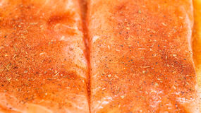 Spices on Salmon Fillets Royalty Free Stock Photography