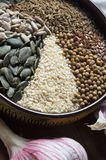 Spices and seeds in ceramic bowl. seasoning. Colorful natural ad Royalty Free Stock Photography