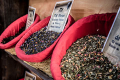 Spices, seeds and tea sold in a traditional market in Granada, S Stock Photos