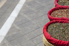 Spices, seeds and tea sold in a traditional street market, Grana Royalty Free Stock Images