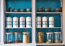 Spices shop. Assortment of spice jars on shelves with price tags Stock Images
