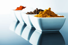 Spices in small bowls Stock Photos