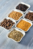 Spices in small ceramic cups Stock Image