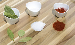 Spices in small dishes on a tray. Stock Photos