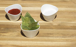 Spices in small dishes on a tray. Stock Image