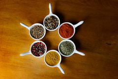 Spices. A spice is a seed, fruit, root, bark, or other plant substance primarily used for flavoring, coloring or preserving food. Spices are distinguished from royalty free stock images