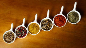 Spices. A spice is a seed, fruit, root, bark, or other plant substance primarily used for flavoring, coloring or preserving food. Spices are distinguished from royalty free stock photos