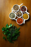 Spices. A spice is a seed, fruit, root, bark, or other plant substance primarily used for flavoring, coloring or preserving food. Spices are distinguished from royalty free stock photo