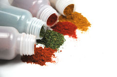 Spices spilling out of jars Stock Photography
