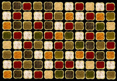 Spices in square green ceramic bowls on black background contrasting picture Stock Photo