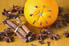 Spices on the table. Cinnamon, cloves, anise, orange Royalty Free Stock Images