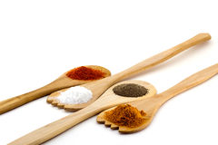 Spices on three wooden spoons isolated on white background Royalty Free Stock Photography