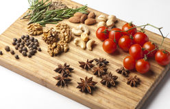 Spices and tomatoes. Cheese fantasy. Spices and tomatoes Stock Photos