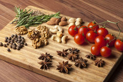 Spices and tomatoes. Cheese fantasy. Spices and tomatoes Royalty Free Stock Image