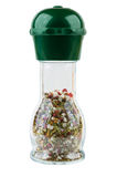 Spices in transparent bottle with mill isolated on white. Background Stock Photography
