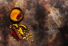 Spices turmeric, cinnamon, cardamom and red hot chili pepper Stock Photography